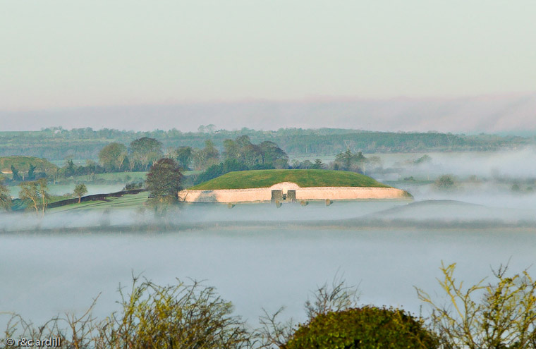 An early morning view of Newgrange with the Boyne valley shrouded in mist