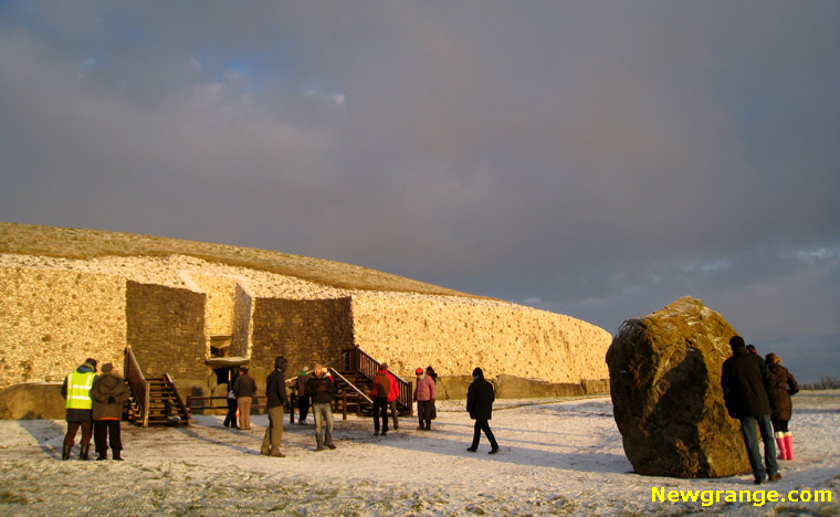 Newgrange illuminated by the rising sun